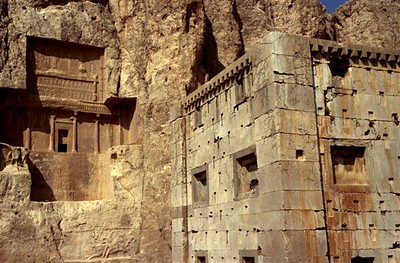 Kaba Zartosht (thought to be a Achaemenid fire temple) in the foreground with the cliff tomb of Xerxes I in the background