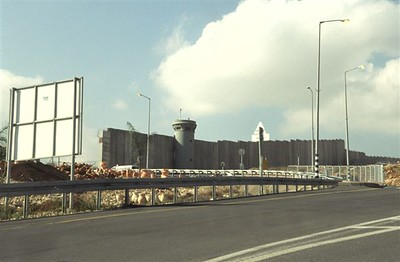 Wall and guard tower overlooking an Israeli entrance checkpoint coming into Jerusalem; not picturesque but historically significant