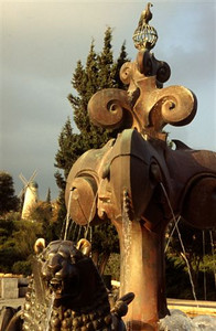 The Bloomfield Gardens' Lion Fountain in the Yemin Moshe district (modern Jerusalem) with the Montefiore's Windmill behind