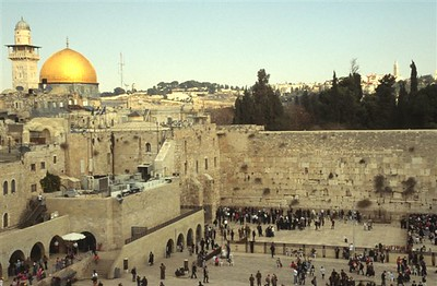 The Western Wall (Ha-Kotel in Hebrew) or Wailing Wall in the Jewish Quarter of Jerusalem with Temple Mount just behind