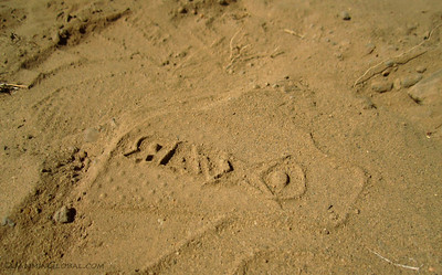 Leaving my boot mark in the sand. I took nothing but photos and left nothing except foot (boot) prints.