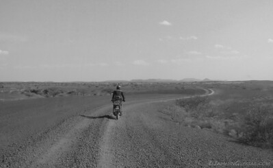 Riding through Africa. By now, my confidence level was high for riding on loose surfaces and I was very comfortable riding sanDRina at a fast pace through this landscape.
