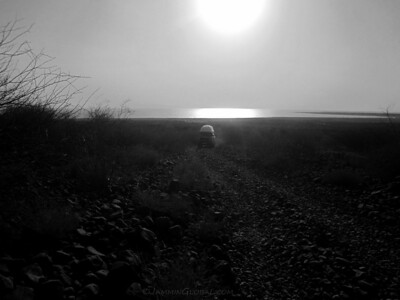 Ferdi and Katie climbing up the rocky route with the sun setting on Lake Turkana.