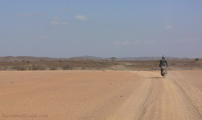 Riding corrugations as the route allowed a faster pace.