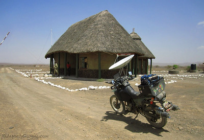 Exiting Sibiloi National Park and getting our first taste of how things work in Kenya. The fee for being in the park was $20 per person and then the fee for a motorcycle was 300 Kenyan Shillings ($3.25). For the van, the Kenya Wildlife Service officer said it was K1000 but it was negotiable. Ok, so we got it down to K500. Nice to be in a land where everything's negotiable.