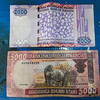 Rwandan Francs showing the country's main foreign exchange earner, gorilla tourism and coffee. Rwanda had close ties with France after independence and it shows in the name of its currency, the use of French in business and government circles and the practice of driving on the right, compared to most of its neighbors who drive on the left (following British influence). USD $1 = RWF 605, so that RWF 5000 note equals about $8.25.