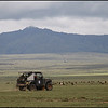 A modified Land Cruiser on the last leg with Mt Longonot looming in the background.