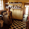 It was time to leave and I said bye to the motel maid in our old kitchen.