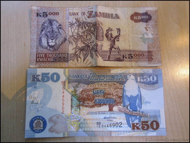 I was back in Zambia during an important moment in its history as the country rebased its currency. They were lobbing off three zeros for a number of reasons that included psychological confidence in the currency and making imports cheaper that the people depend on. During my time in Zambia, the Kwacha was a pretty strong currency as it was pegged to the dollar at 1.2 Kwacha. But in the late 80s and early 90s, poor policies were catching up with the country and high inflation set in. That was also when many long time resident expats moved out of Zambia, including my family. Now, when I arrived back in Zambia, the Old Kwacha was trading at 5,250 to the dollar. After the new year, it would be 5.25 to the dollar.