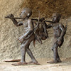 Metal art sculptures depicting San life are scattered around Camp Amalinda.
