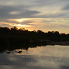 Hippos and sunset over the Sand River