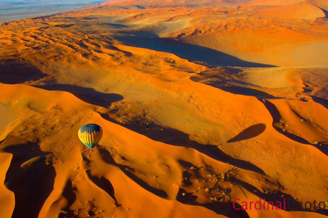Ballooning over the Namib Desert in Sossousveli is a life changing experience. The sheer scale of wild nature is breath-taking. The silence of the balloon ride only reinforces the majesty of the terrain underneath.<br /> <br /> Sossusvlei, Namibia. 1/ 180s, at f/13 || E.Comp:0 || 24mm || WB: AUTO 0. || ISO: 400 || Tone: AUTO || Sharp: AUTO || Camera: NIKON D2Xon: 2005:11:16 20:55:43