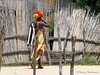 Woman carrying bag of oranges - Etsha Okavango Delta, Botswana