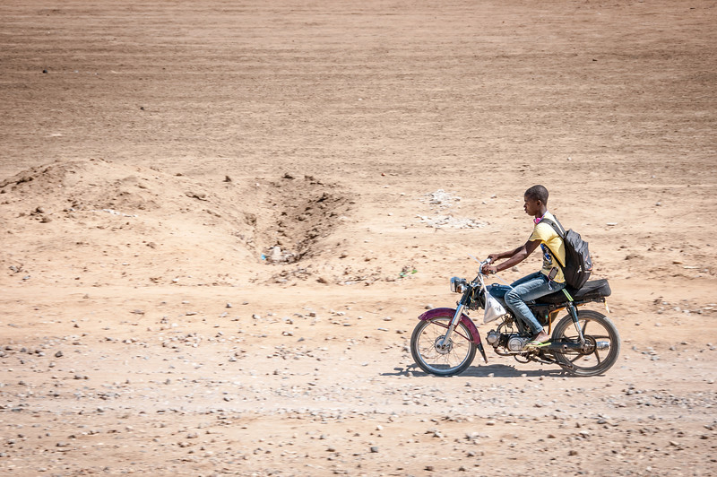 Local riding a motorcycle in Lobito, Angola