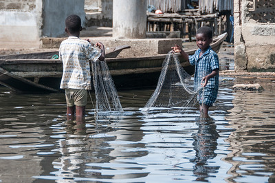 Kids fishing in Cotonou, Benin