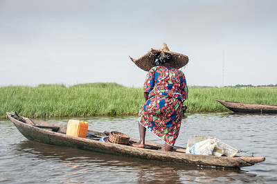Woman in boat in Cotonou, Benin