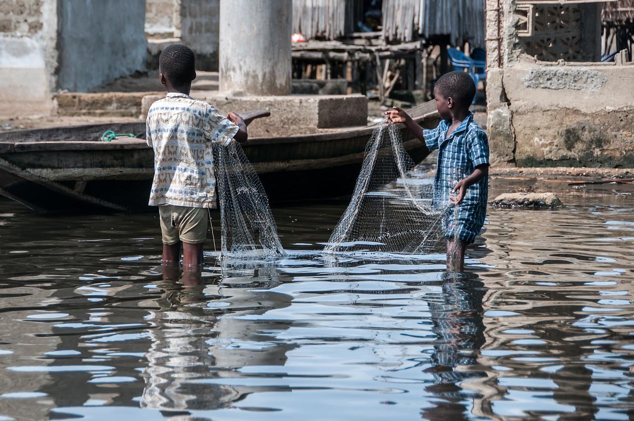 Kids fishing in Cotonou, Benin