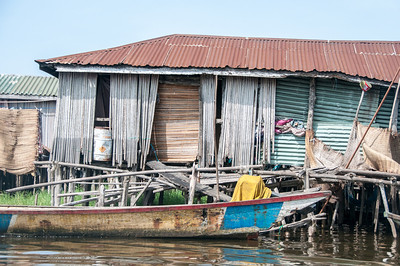 Boat and house in a fishing village in Cotonou, Benin