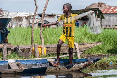 Kid fishing in Cotonou, Benin
