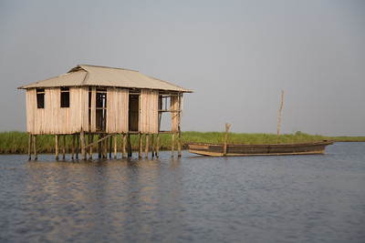 GANVIE, BENIN - DECEMBER, 2006: The fishing town of Ganvie built completely on stilts and accessable only by water.27,000 villagers live here in bamboo huts on Lake Nokoue near Cotonou. ( Photo by: Christopher Herwig )