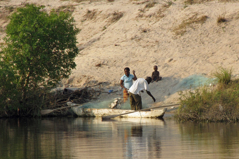 Namibian fisherman and family prepare their net for a night of fishing.