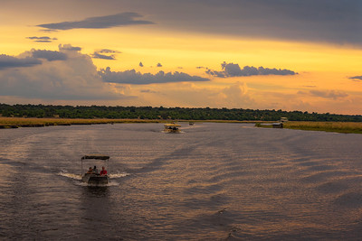 People on a sunset safari cruise on Chobe River in Chobe National Park, Botswana