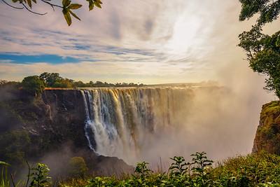 Sunset at the Victoria Falls on Zambezi River in Zimbabwe