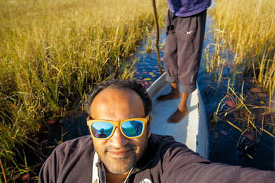Enjoying stunning Okavango Delta on mokoro.