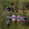 Tourists go for a Mokoro ride
