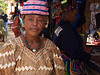 Woman modeling a hat, Foumban market