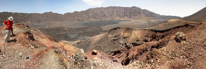 My friends Bernie Acre (front) and Matthew Acre (behind) anchor a panorama of the island's crater taken from atop the 1995 volcanic cone.<br /> <br /> This is an 11-shot panorama stitched together in Photoshop CS5.<br /> <br /> Location: Chã das Caldeiras, Fogo island, Cape Verde<br /> <br /> Lens used: Canon 17-55mm f2.8 IS