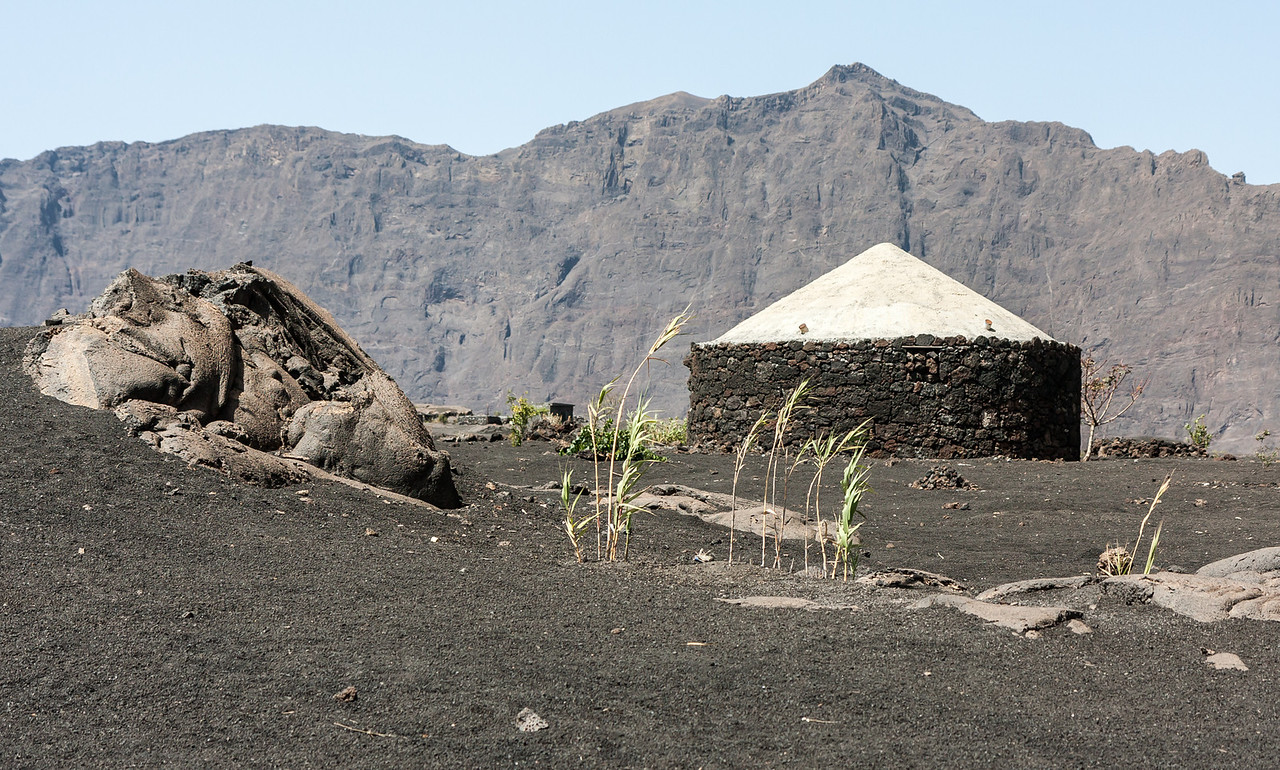 The distinctive round houses found inside the crater are falling more and more out of favor for modern buildings.<br /> <br /> Location: Chã das Caldeiras, Fogo island, Cape Verde<br /> <br /> Lens used: Canon 17-55mm f2.8 IS