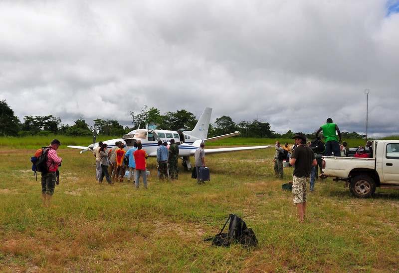 Unloading supplies after bush flight to Bayanga Village on Sangha River, Central African Republic.