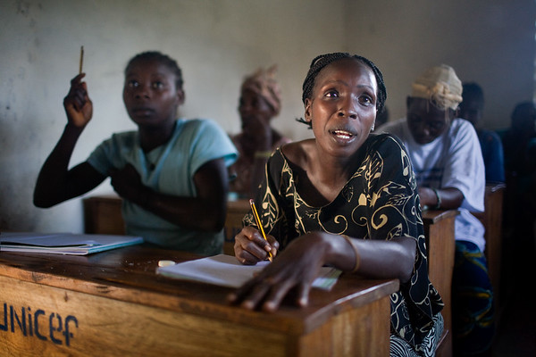 UNMIL Photo/Christophe Herwig - Ganta, Liberia, July 30, 2008 :  The Ganta Concerned Women's Group has organized a pilot project to teach women in Tonglewin village how to read and do basic mathematics.  Liberia's electricity system was destroyed in the war, and power has not yet been restored. Classes are conducted in semi-darkness twice a week.
