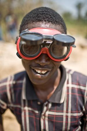 Portrait of a happy Liberian man wearing big googles