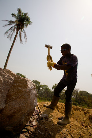 Workers at a gravel pit on the  Voinjama - Foya road breaking rock for local highway construction, January 22, 2007,  Voinjama, Lofa County,  Liberia.