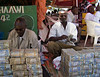 Moneychangers, Hargeisa, Somaliland.  The fact that these guys sit out in the street with piles of money in front of them is often used as an example of how safe Somaliland is.  Try this in New York.