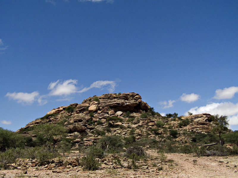 Las Geel, Somaliland.  I had come to Somaliland mainly to see the ancient paintings at Las Geel.  This unprepossessing looking hill is where the paintings are to be found.  The site is at least 3,000 years old, and includes dozens of stylized paintings of cows and a few other figures.