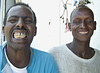 Somali and Afar, Djibouti City, Djibouti.  Unbidden by me, the Somali man on the left cajoled the Afar man on the right into showing me his sharpened teeth.