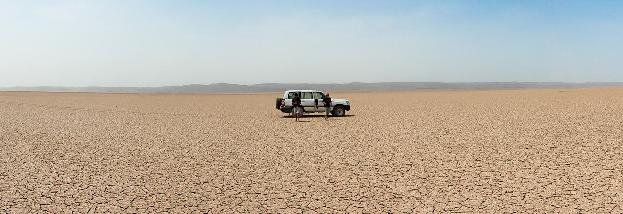 Pit stop in the middle of a dried lake bed.<br /> <br /> This is a crop of an 8-shot panorama stitched together in CS5.<br /> <br /> Location: Djibouti countryside<br /> <br /> Lens used: 24-105mm f4.0 IS