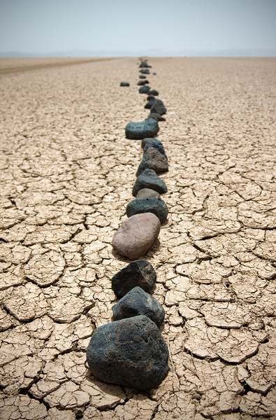 The line of rocks served as roadway delineator across a dried lake bed.<br /> <br /> Location: Djibouti countryside<br /> <br /> Lens used: 24-105mm f4.0 IS