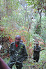 Good news. We meet our advance trackers who have located the gorillas.