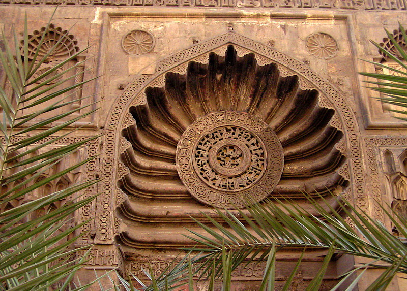 Al-Aqmar mosque entrance, Cairo.  This central medallion at the front of the 900-year-old mosque has Kufic script carved intricately right through the stone.