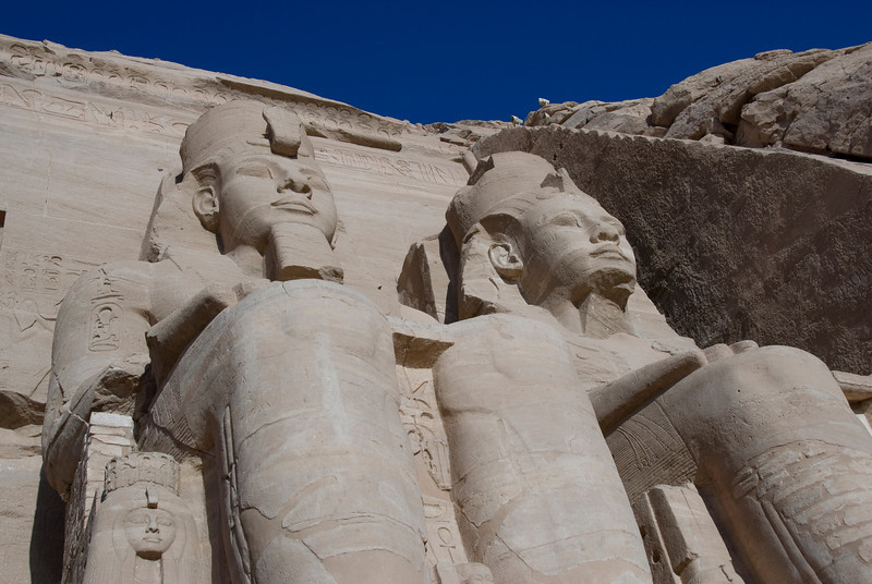 Looking up two giant carving of Egyptian Pharaoh - Abu Simbel, Egypt
