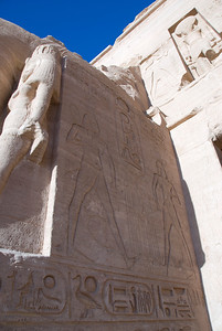 Looking up ancient hieroglyphics at a wall in Abu Simbel - Egypt