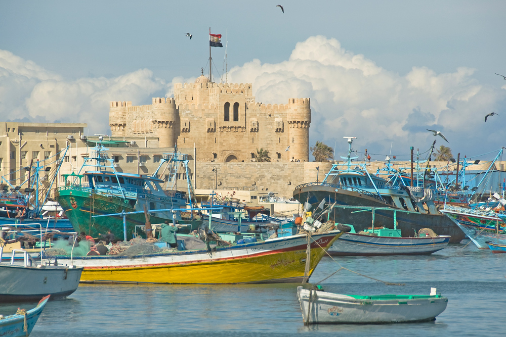 Boats and Fort Qataby in Alexandria, Egypt