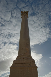 Looking up the Pompey's Pillar and clouds - Alexandria, Egypt