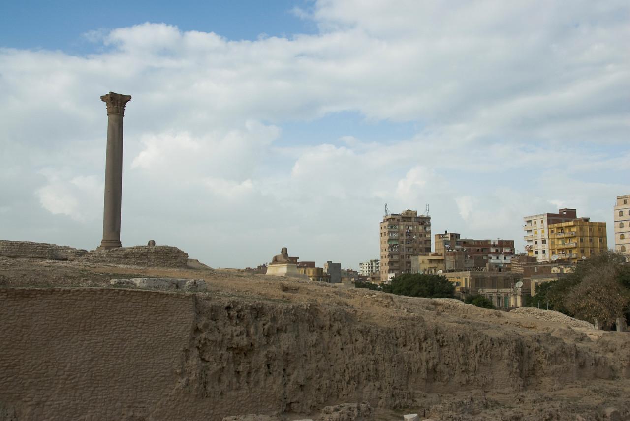 Pompey's Pillar against the city skyline - Alexandria, Egypt
