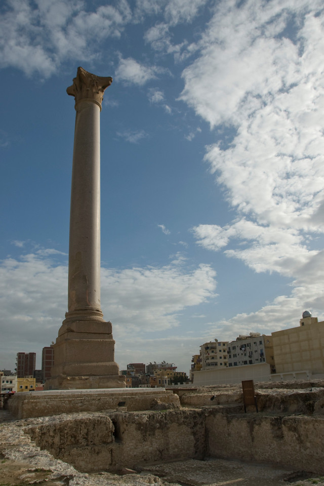 Pompey's Pillar towering above ruins in Alexandria, Egypt