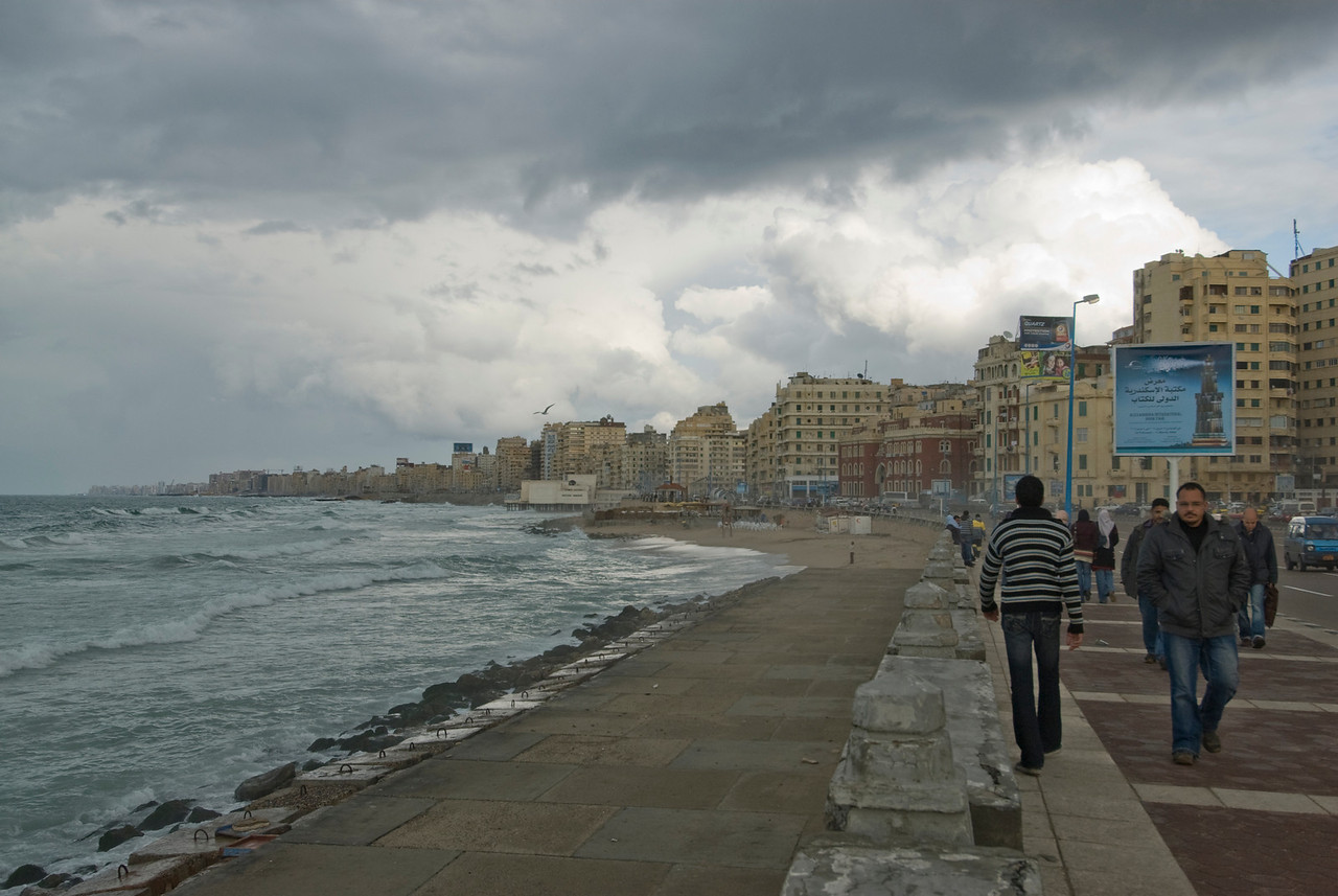 Locals walking along the harbor front - Alexandria, Egypt